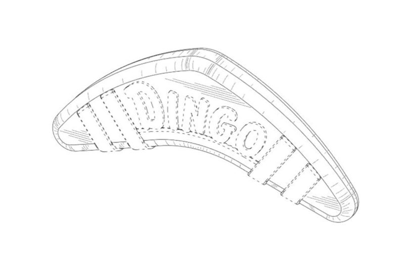 "The pet treat is shaped like a boomerang and the brand name ""Dingo"" is embossed on the front of the design.