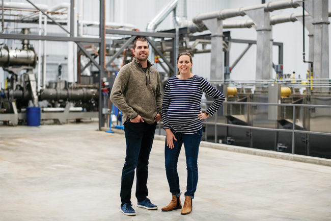 Co-directors and siblings, Sarah Barrett Reiner (right) and Tom Barrett (left), currently employ 250 people between the two BPI processing facilities in rural Minnesota.