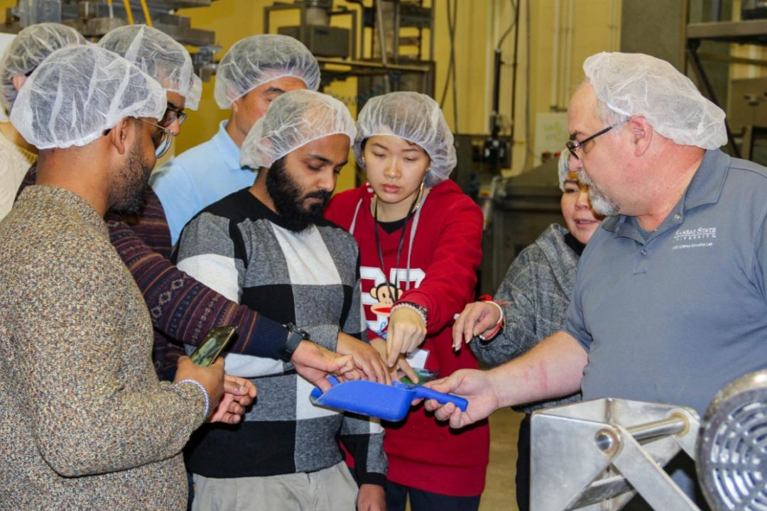 Course participants getting hands-on pet food extrusion training