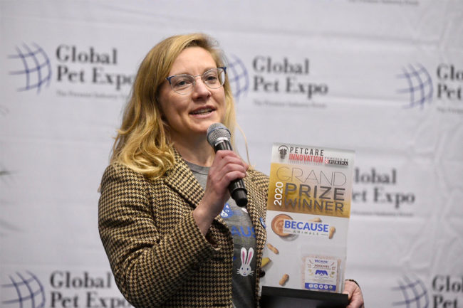 Shannon Falconer, CEO of Because Animals, accepts the grand prize from Purina's Pet Care Innovation program