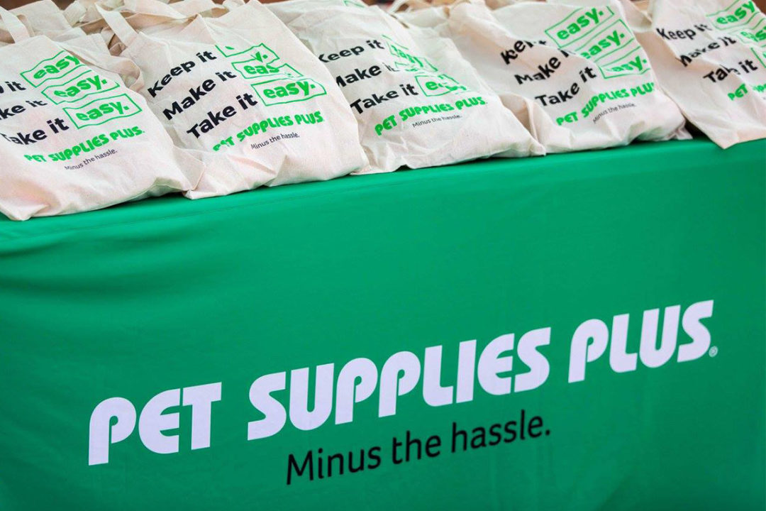 Pet Supplies Plus logo on green tablecloth