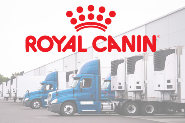 Royal Canin logo with semi-truck background (©STOCKR - STOCK.ADOBE.COM)