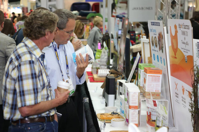 Image of two men looking at product during SuperZoo (2018)