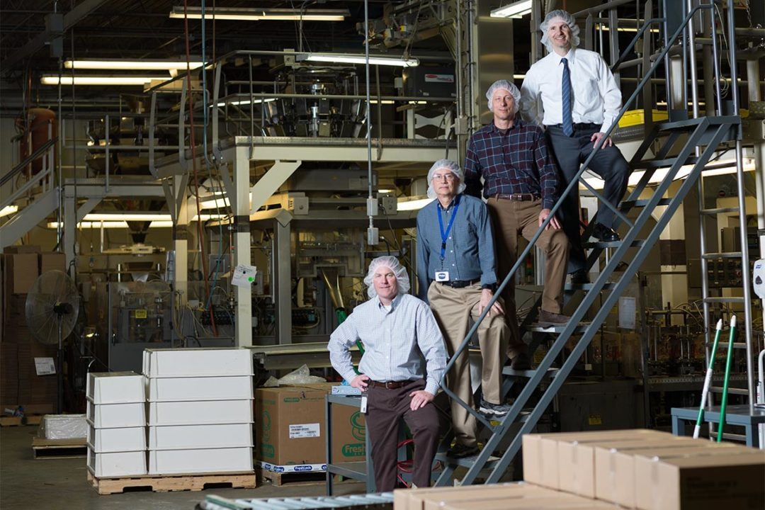 Phelps Pet Products executive team inside Rockford, Illinois facility