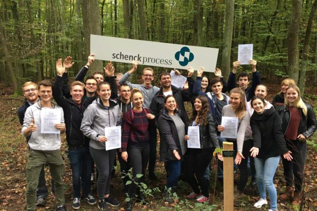 Trainees plant trees as part of Schenck Process's environmental efforts
