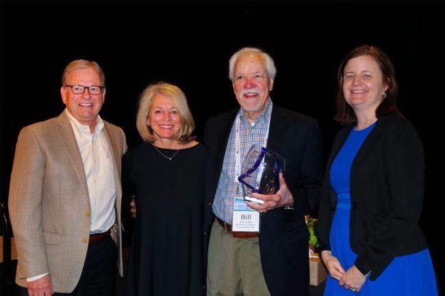 Bill Barr with his wife and AFIA executives Joel G. Newman and Sarah Novak