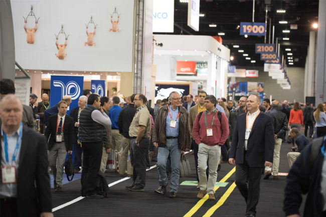 People walking around exhibitions at IPPE