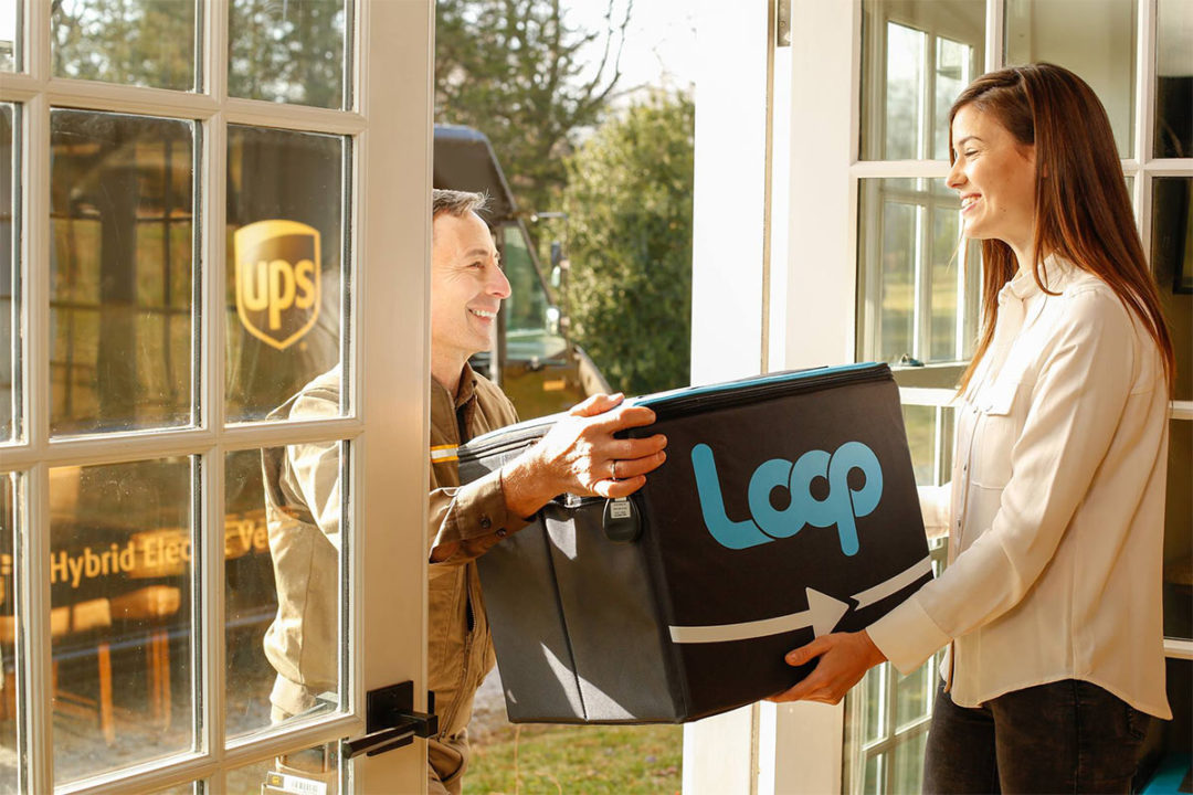 Loop delivery, UPS man handing Loop bag to consumer