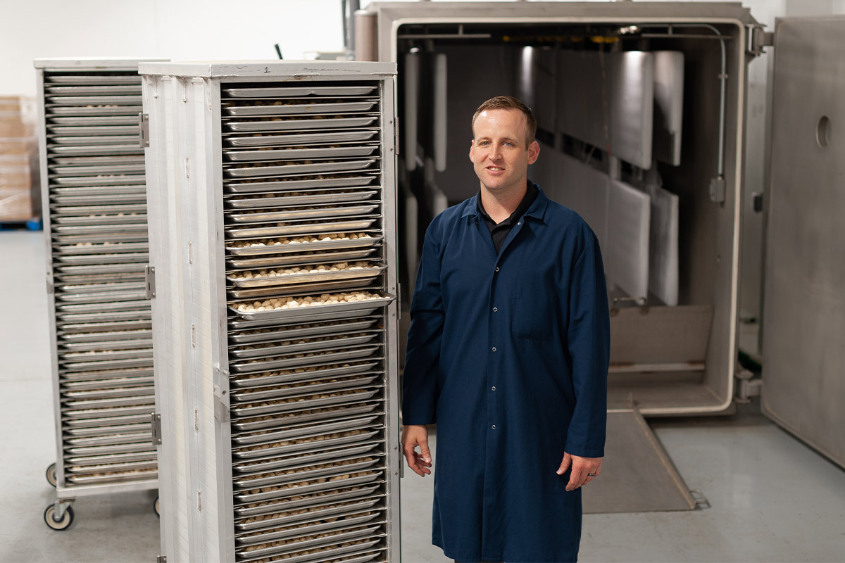 Muenster Milling President Mitch Felderhoff in front of industrial freeze-dryer