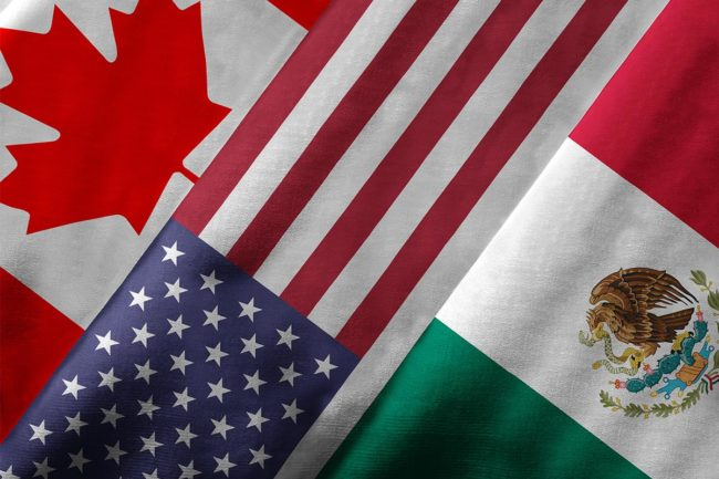 North American flags: Canada, the United States, and Mexico (©STOCKR - STOCK.ADOBE.COM)