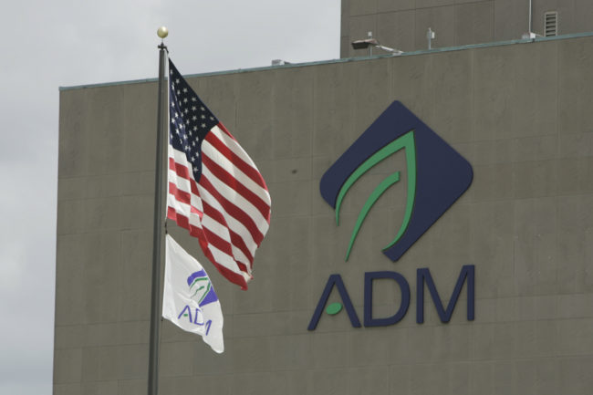 ADM building with logo and flags